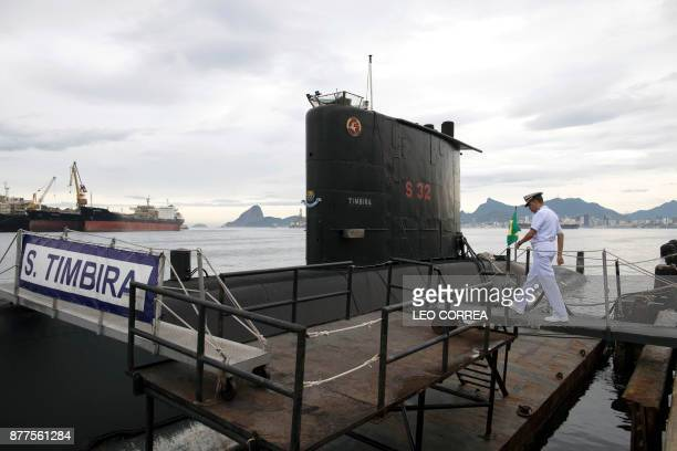 Brazilian Navy Captain Jose Americo Alexandre Dias walks towards the Brazilian submarine Timbira in Rio de Janeiro Brazil on November 22 whilst other...