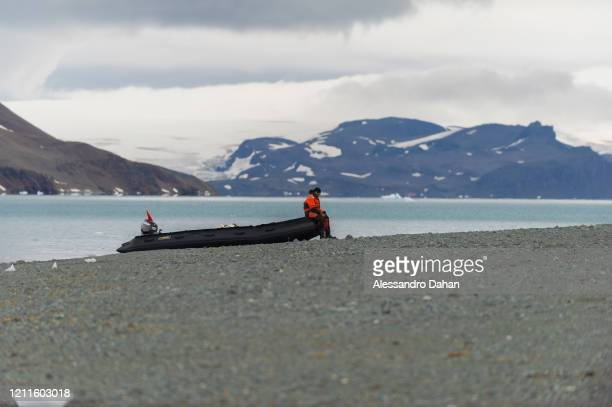 Brazilian Navy diver supporting researchers' expedition waits on Punta Ullmann beach sitting on zodiac, on January 04, 2020 in King George Island,...