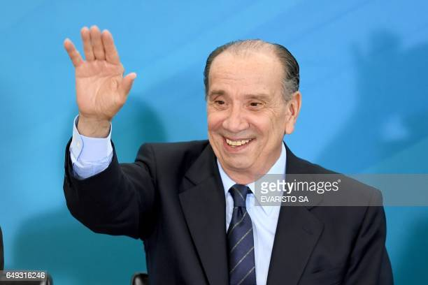 Brazilian new Foreign Minister Aloysio Nunes Ferreira waves during his swearing in ceremony at Planalto Palace in Brasilia on March 7 2017 Nunes...
