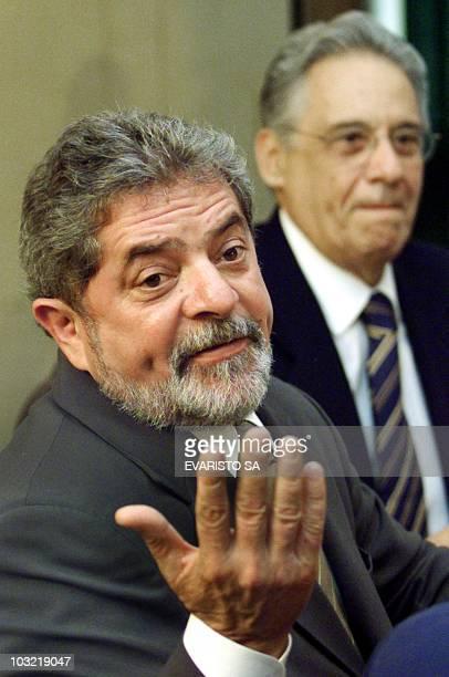 Brazilian newly elected President Luiz Inacio Lula da Silva talks with a journalist during a meeting with ruling President Fernando Henrique Cardoso,...