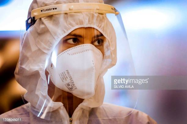 Brazilian nurse Tuanny Neto poses for a photograph wearing protection gear during a break between shifts at the Intensive Care Unit of the Santa Casa...