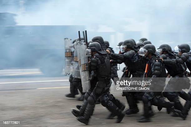 Brazilian paramilitary police CHOQUE batallion personnel in riot gear drill at the general police headquarters in Rio de Janeiro Brazil on March 15...