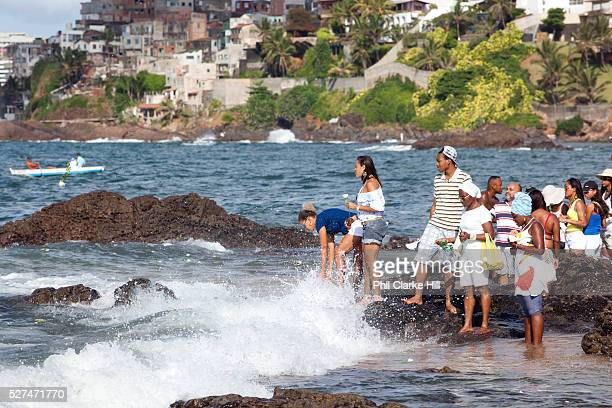 Brazilian People making offering of flowers to the sea in honour of Yemanja February 2nd is the feast of Yemanja a Candomble Umbanda religious...