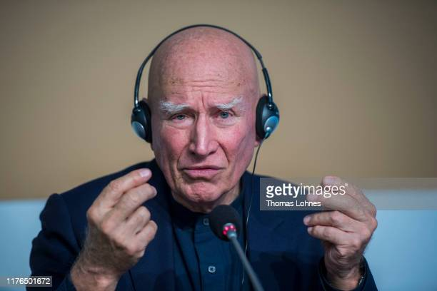 Brazilian photographer Sebastiao Salgado speaks to the media at the press conference for receiving the Peace Prize Of The German Book Trade on...