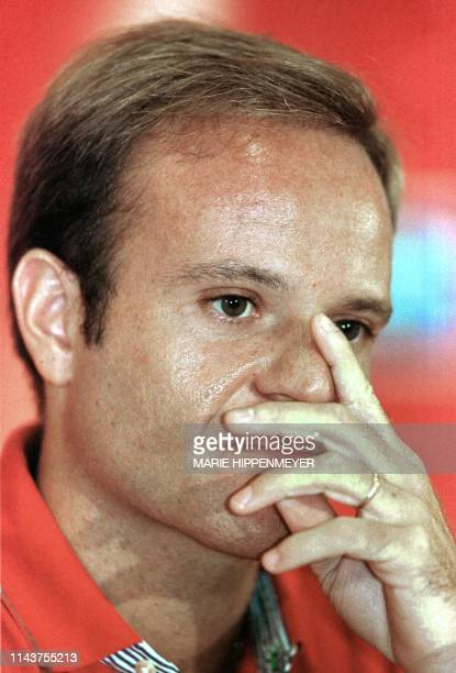 Brazilian piolot, Rubens Barrichello, listens to journalists' questions during a press conference in San Pablo 02 February, 2000. Barrichello is the...