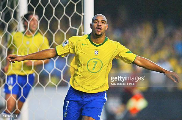 Brazilian player Adriano celebrates his goal against Bolivia at the Morumbi stadium in Sao Paulo 05 September 2004 for the FIFA World Cup Germany...