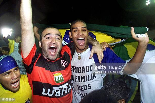 Brazilian player Adriano celebrates with a supporter of Flamengo de Rio de Janeiro the champ title for the XX South American Football Sub 20...