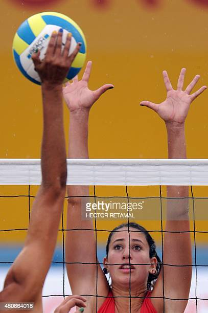 Brazilian player Carolina Horta vies for the ball with Pilar Mardones of Chile during the Women's Beach Volleyball Preliminary at the 2015 Pan...