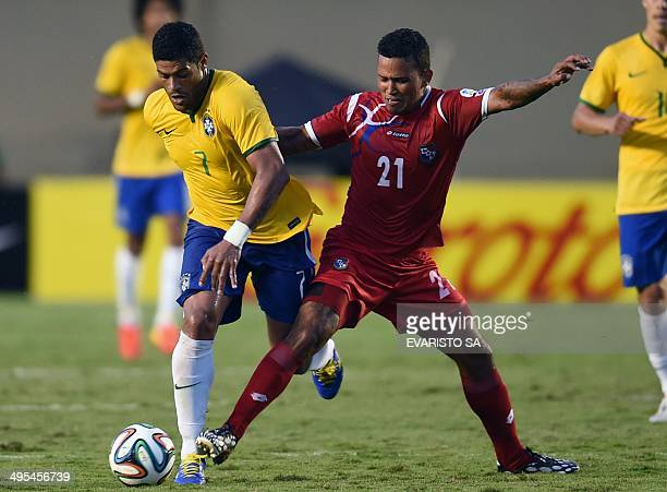 Brazilian player Hulk vies for the ball with Panama's Amilcar Henriquez during a friendly match against Panama in preparation for FIFA World Cup...