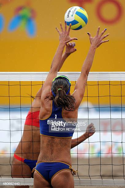Brazilian player Liliane Maestrini vies for the ball with Francisca Rivas of Chile during the Women's Beach Volleyball Preliminary against Chile at...