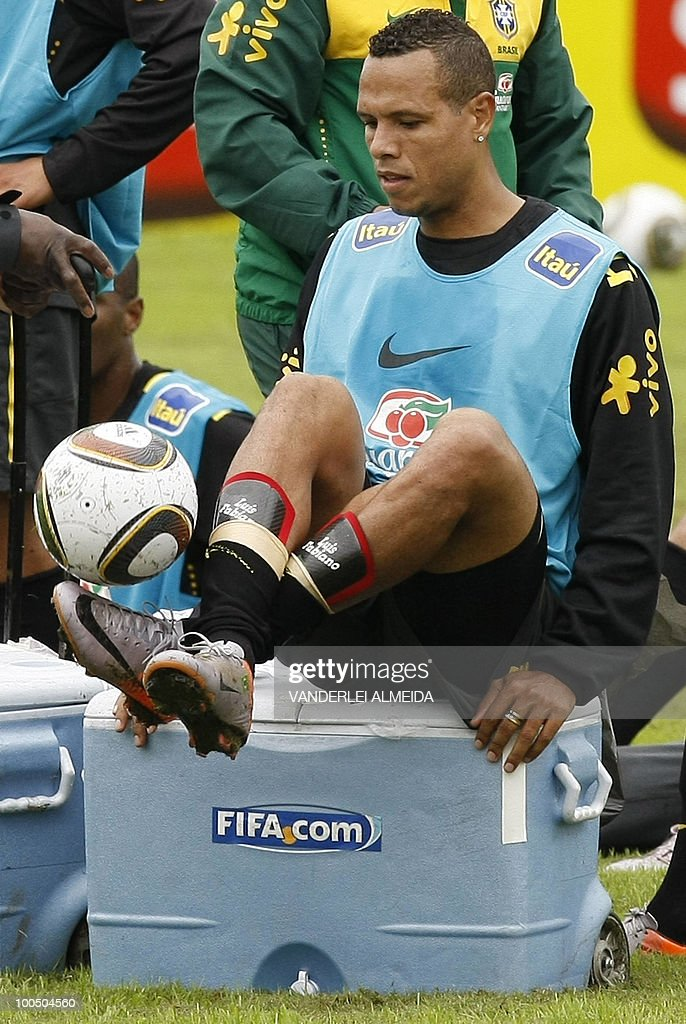 Brazilian player Luis Fabiano plays with the ball at the end of a traning session in Curitiba, southern Brazil on May 25, 2010.