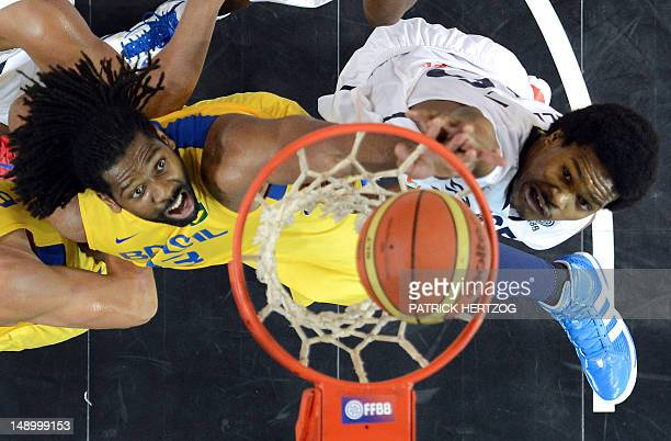 Brazilian player Nene Hilario vies with France's player Mickael Gelabale during the basketball match France vs Brazil in Strasbourg eastern France on...