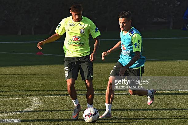 Brazilian player Neymar and Philippe Coutinho take part in a training session at the Azul training center in Santiago Chile during the 2015 Copa...