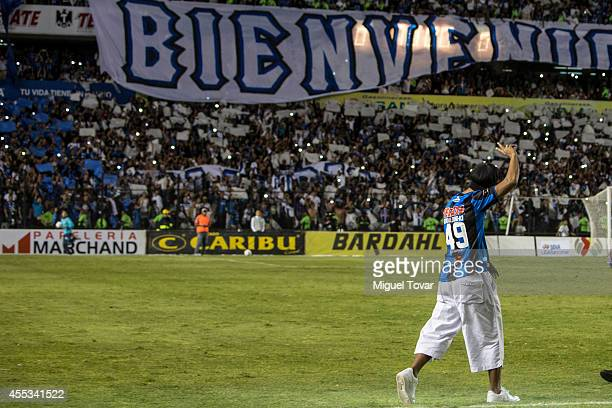 Brazilian player Ronaldinho Gaucho of Querétaro greets fans prior a match between Queretaro and Puebla as part of Apertura 2014 Liga MX at...