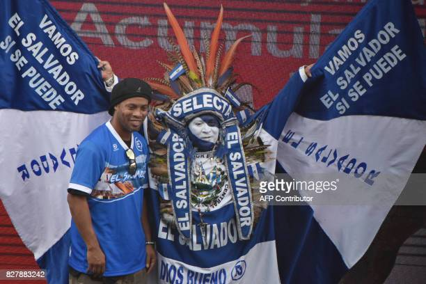 TOPSHOT Brazilian player Ronaldinho poses with the Salvadoran character known as the Indio Cuscatleco at the National Stadium Jorge 'Mágico' Gonzalez...