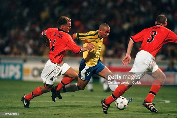 Brazilian player Ronaldo between Franck de Boer and Jaap Stam of the Netherlands during the semifinals of the 1998 FIFA World Cup Brazil vs...
