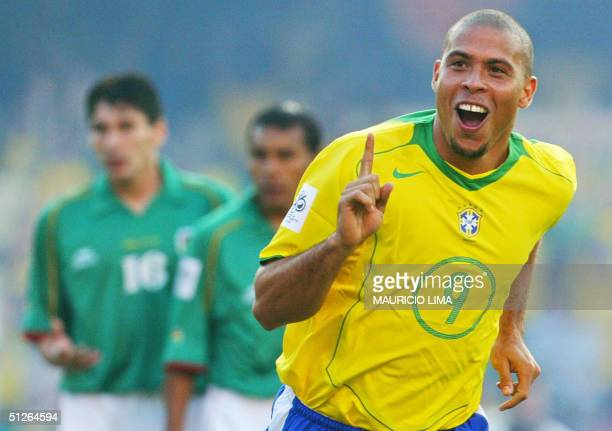 Brazilian player Ronaldo Nazario celebrates his goal against Bolivia at the Morumbi stadium in Sao Paulo 05 September 2004 for a FIFA World Cup...