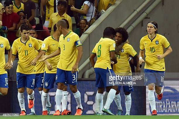 Brazilian player Willian celebrates with teammates after scoring against Venezuela during their Russia 2018 FIFA World Cup South American Qualifiers...