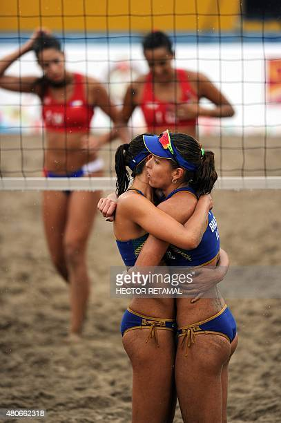 Brazilian players Carolina Horta and Liliane Maestrini celebrate after their win in the Women's Beach Volleyball Preliminary against Chile at the...