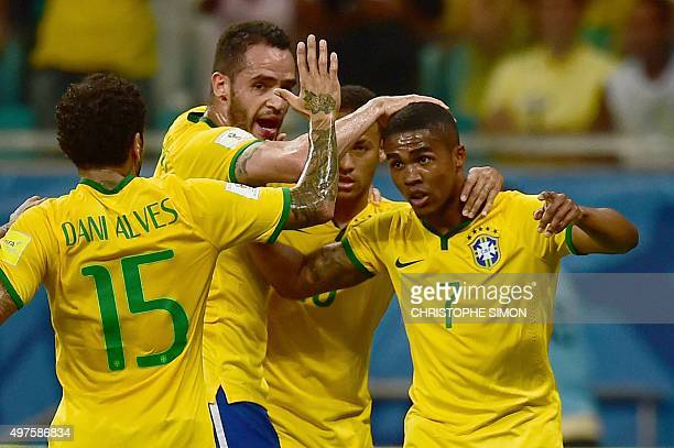 Brazilian players celebrate after Douglas Costa scored against Peru during their Russia 2018 FIFA World Cup South American Qualifiers football match...