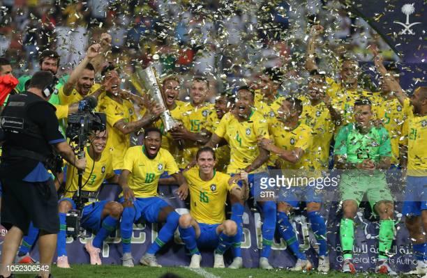 Brazilian players celebrate after winning the international friendly match Brazil vs Argentina at the King Abdullah Sport City Stadium in Jeddah on...