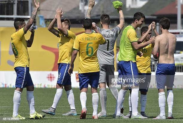 Brazilian players celebrate after winning the Pan American Games football match for the bronze medal against Panama in Hamilton Canada on July 25...