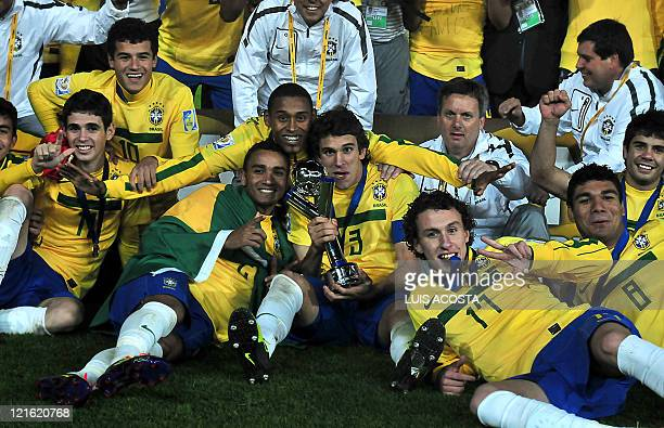 Brazilian players celebrate at the end of the FIFA 2011 Under20 World Cup final match against Portugal in Bogota on August 20 2011 Brazil won 32 in...