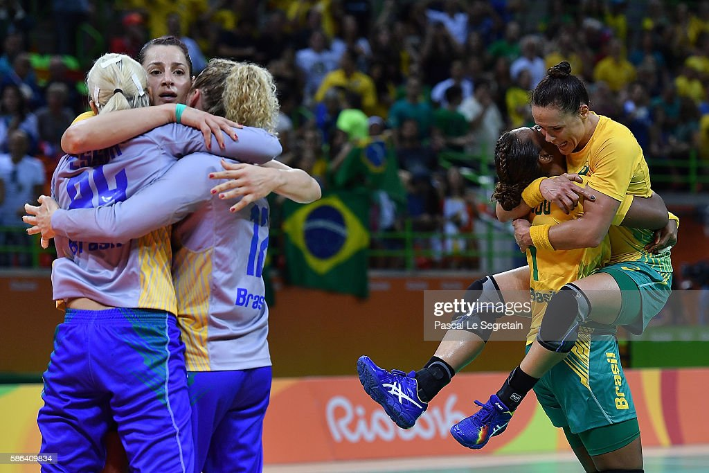 Brazilian players celebrate their victory at the end of the women's preliminaries Group A handball match Norway vs Brazil on Day 1 of the Rio 2016 Olympic Games at Future Arena on August 6, 2016 in Rio de Janeiro, Brazil.