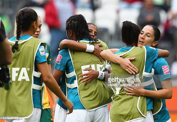 Brazilian players embrace after Brazil defeated Australia at the FIFA Women's World Cup 2011 Group D match between Brazil and Australia at the...