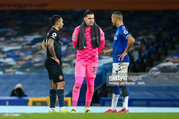 Brazilian players Gabriel Jesus and Ederson of Manchester City and Richarlison of Everton talk at full time during the Premier League match between...