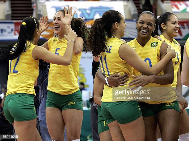 Brazilian players Jaqueline Carvalho Caroline Gattaz Marcelle Moraes Welissa Gonzaga and Natalia Pereira celebrate after winning the 2005 World Grand...
