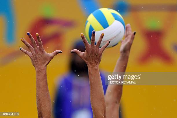 Brazilian players Liliane Maestrini vies for the ball with Pilar Mardones of Chile during the Women's Beach Volleyball Preliminary at the 2015 Pan...