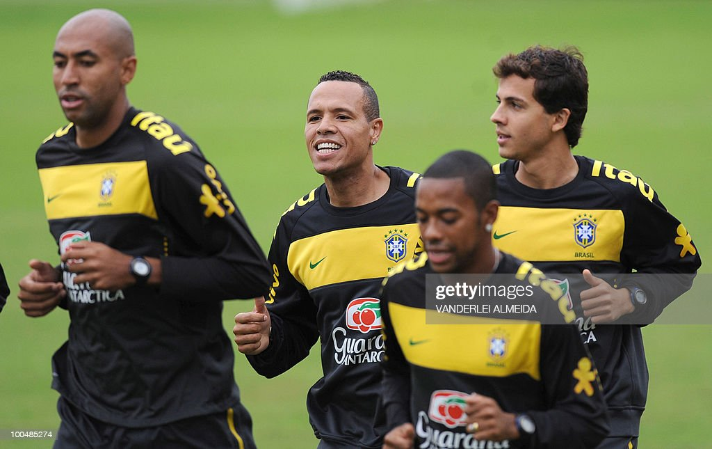 Brazilian players (L to R), Luizao, Luis Fabiano, Robinho and Nilmar jog during a training session in Curitiba, southern Brazil on May 24, 2010. Brazil, five-time world champion, is among the favourites for the South Africa 2010 World Cup which starts on June 11th. The 'Selecao' have been drawn in Group G with North Korea, Ivory Coast and Portugal.