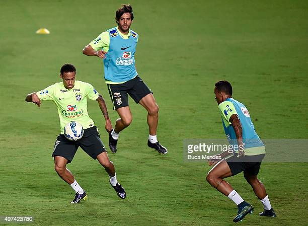 Brazilian players Neymar Kaka and Luiz Gustavo take part in a training session at the Pituaçu stadium on the eve of the 2018 FIFA World Cup Russia...