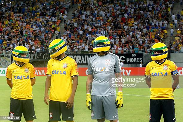 Brazilian Players of Corinthians football club wear replicas of the helmet worn by Brazilian's F1 driver Ayrton Senna before the start of their Copa...