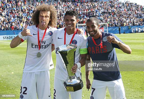 Brazilian players of PSG David Luiz Thiago Silva and Lucas Moura celebrate with trophy as PSG wins the 2015 Trophee des Champions between Paris...