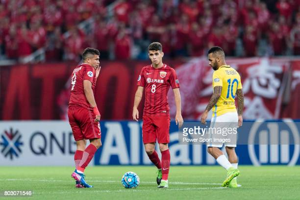 Brazilian players of Shanghai FC Oscar Emboaba Junior Elkeson De Oliveira Forwards of Shanghai SIPG and Jiangsu FC Forward Alex Teixeira during the...
