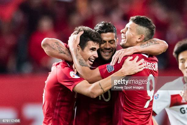 Brazilian players Oscar Hulk and Elkeson de Oliveira celebrating a score during the AFC Champions League 2017 Group F match between Shanghai SIPG FC...