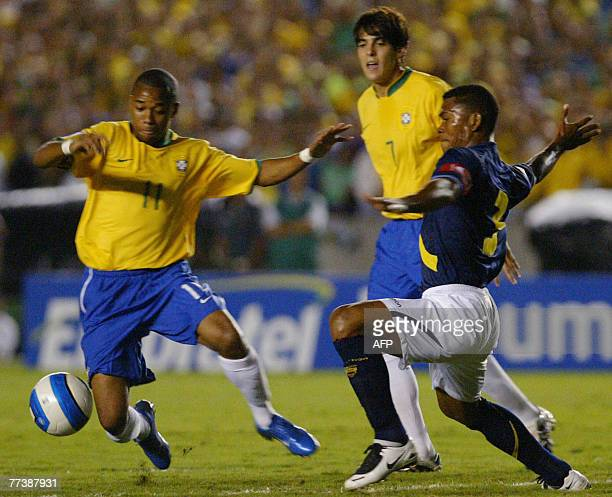 Brazilian players Robinho and Kaka vie for the ball with Ecuadorean Ivan Hurtado during their FIFA World Cup South Africa2010 qualifier football...