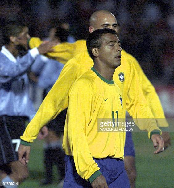 Brazilian players Romario and Cris retire from the field following defeat by Uruguay in their 2002 FIFA World Cup KoreaJapan qualifying match 01 July...