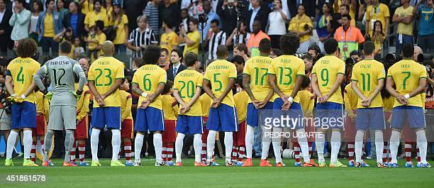 Brazilian players stand during playing of national anthems ahead of the semifinal football match between Brazil and Germany at The Mineirao Stadium...