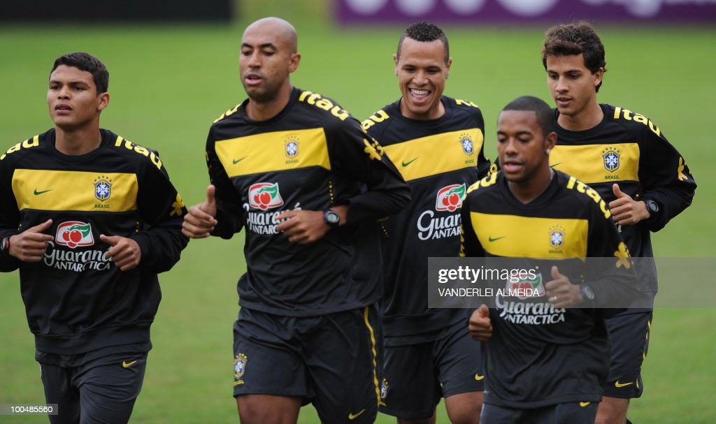 Brazilian players Thiago Silva, Luizao, Luis Fabiano, Robinho and Nilmar jog during a training session at a training centre in the southern Brazilian city of Curitiba on May 24, 2010. Brazil, five-time world champions, are among the favourites going into this year's tournament in South Africa 2010 World Cup , which starts on June 11. The Selecao have been drawn in Group G with North Korea, Ivory Coast and Portugal.