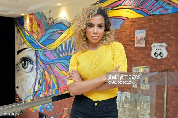 Brazilian pop singer Anitta poses at her home in Rio de Janeiro on April 11 2018 From Honório Gurgel neighbourhood in the violent outskirts of Rio to...