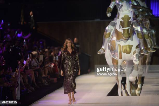 Brazilian pregnant top model Ana Beatriz Barros walks the runway during the Dosso Dossi Fashion Show in Antalya, Turkey on June 09, 2017.