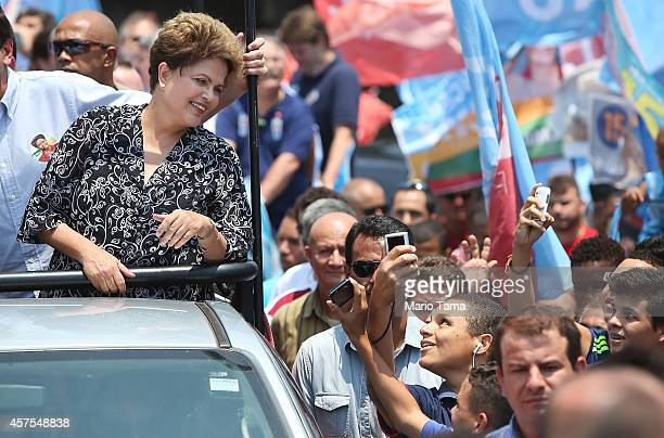 Brazilian president and presidential candidate of the Workers Party Dilma Rousseff looks at supporters during a campaign visit in the Padre Miguel...