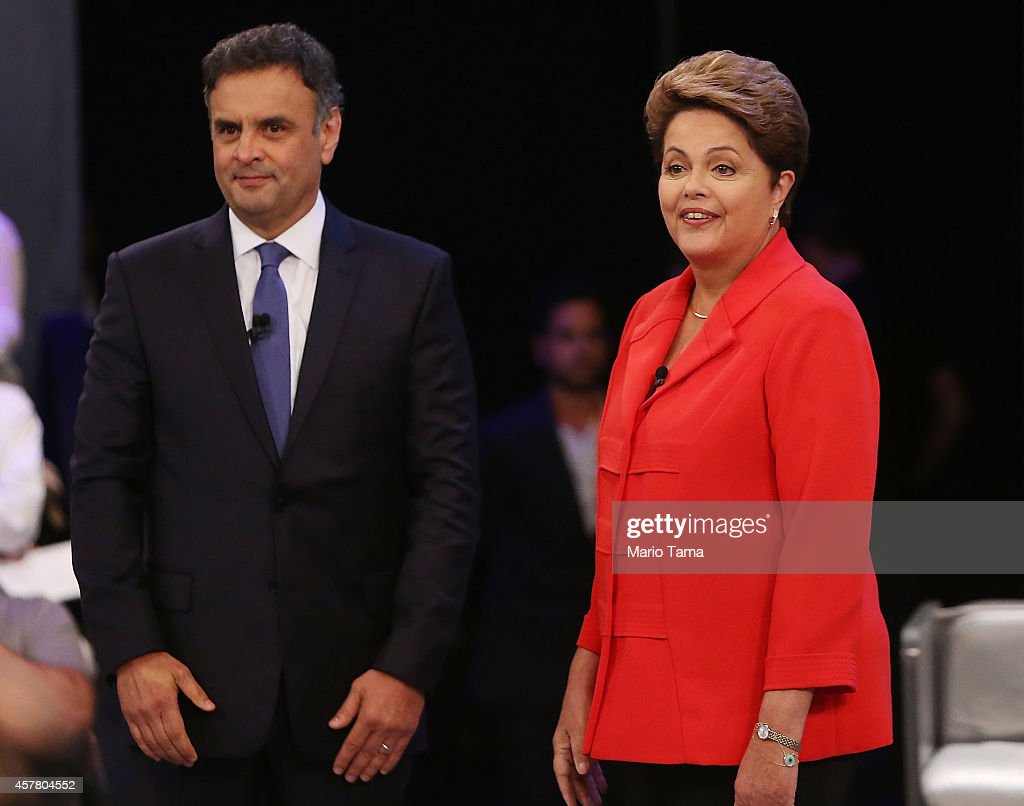 Brazilian President and Workers' Party (PT) candidate Dilma Rousseff (R) stands with Presidential candidate of the Brazilian Social Democratic Party (PSDB) Aecio Neves prior to their final debate on October 24, 2014 in Rio de Janeiro, Brazil. The two are squaring off in a run-off election on October 26.
