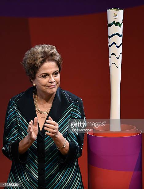 Brazilian President Dilma Roussef gestures during a ceremony for presents the Olympic Torch and Relay Route of the Rio 2016 Olympic Games on July 3...