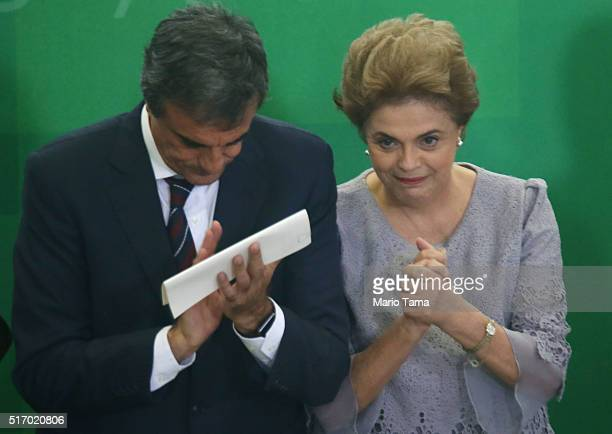 Brazilian President Dilma Rousseff and Attorney General Jose Eduardo Cardozo react at a meeting with supporters from the legal community at the...