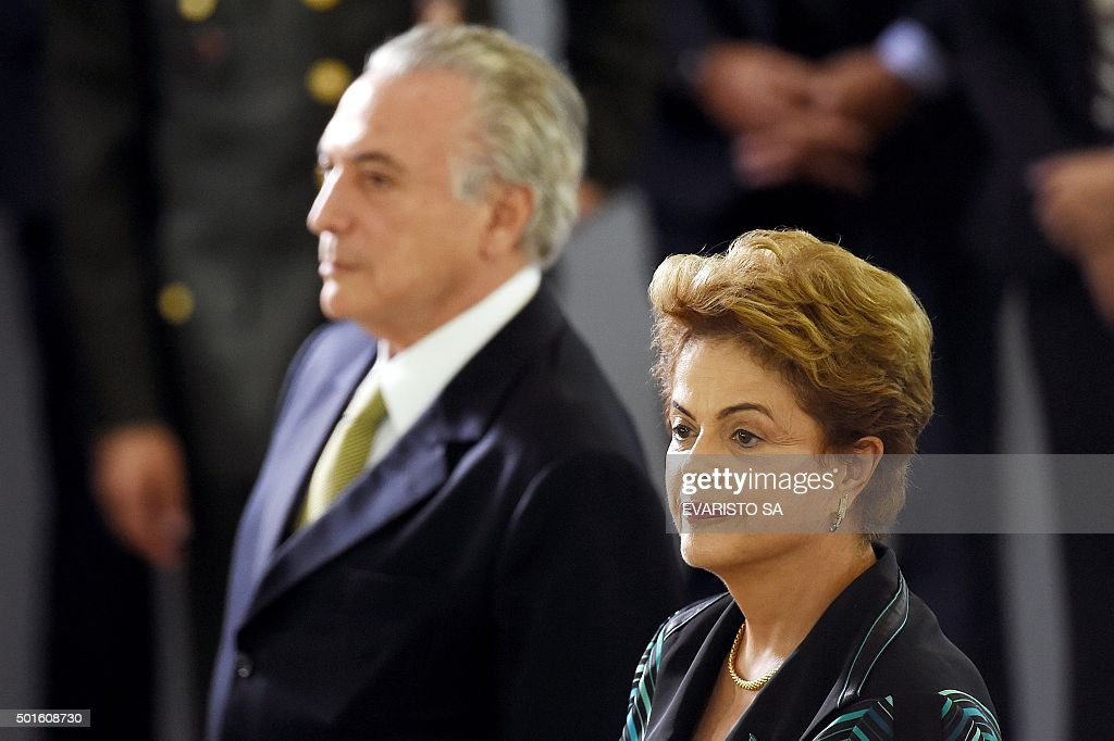 Brazilian President Dilma Rousseff (R) and her Vice President Michel Temer during the presentation ceremony of the new army generals at the Army Club in Brasilia, on December 16, 2015. Rousseff is fighting for her political life as she stands accused of illegal budgeting manoeuvres that she says were long-accepted practices by previous governments.