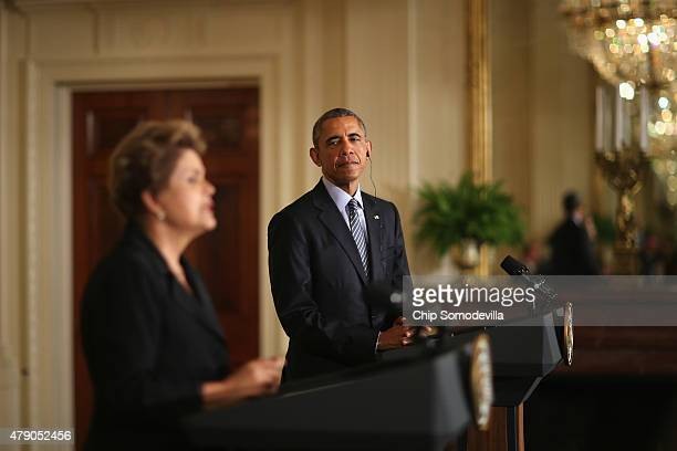 Brazilian President Dilma Rousseff and US President Barack Obama hold a joint news conference in the East Room at the White House June 30 2015 in...